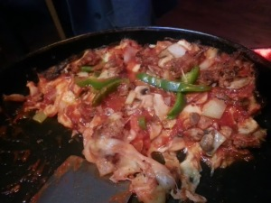 Pequod's pan pizza; so hungry I didn't get a picture until after eating two slices.