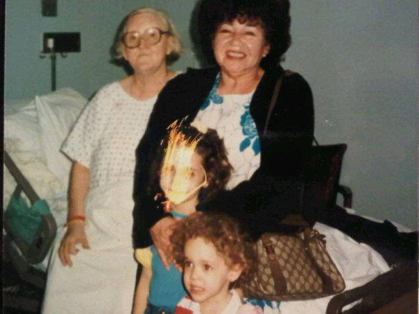 Visiting Grandma Evelyn in the hospital circa 1988ish, with Grandma Delia & Minnie (whose face is scratched out because I was a bit of a wild child)